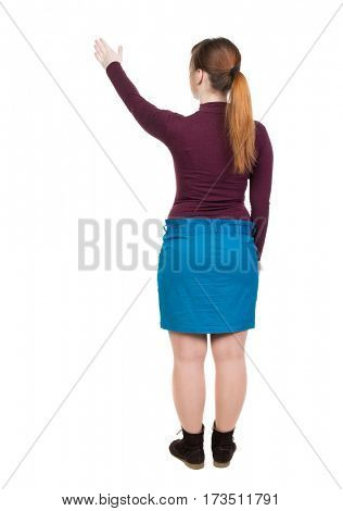 Back view of  pointing woman. beautiful girl. Rear view people collection.  backside view of person.  Isolated over white background. A woman in a dress holding a tour.