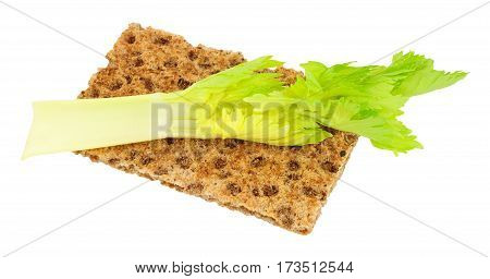 Crisp bread with celery stalk low calorie diet food isolated on a white background