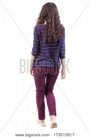 back view of walking  woman. beautiful girl in motion.  backside view of person.  Rear view people collection. Isolated over white background. Curly girl in red jeans walks