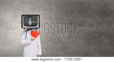 Doctor with TV instead of head    . Mixed media