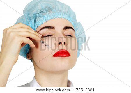 Cosmetic medicine smoothing nasolabial folds. Isolated on white background