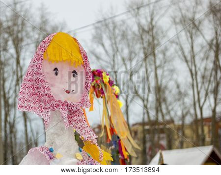 The Effigy Of Maslenitsa. Bright doll in Russian national clothes. Winter