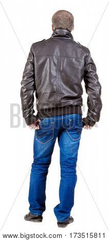 Back view of handsome man in jacket  looking up.   Standing young guy in jeans and  jacket. Rear view people collection.  backside view of person.  Isolated over white background.