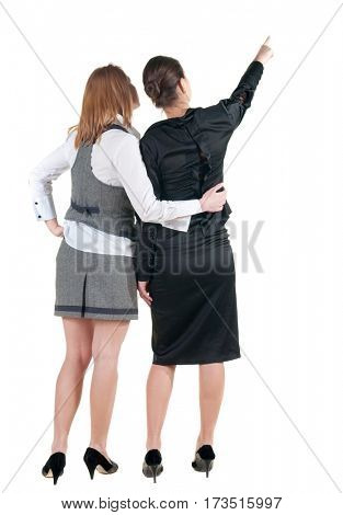 back view of businessteam. two young  business woman pointing.  Rear view people collection.  backside view of person.  Isolated over white background.