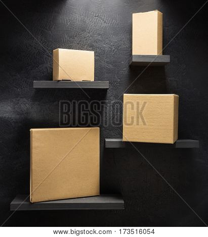 cardboard box on wooden shelf black background surface