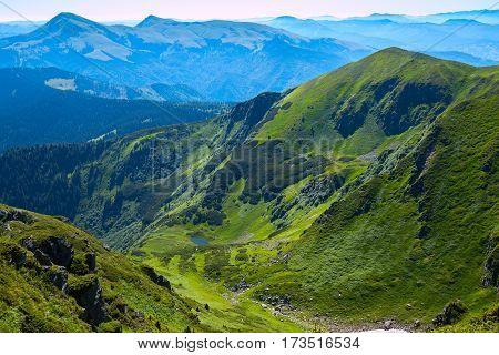 Amazing Mountain Gorge Among The Green Alpine Meadows