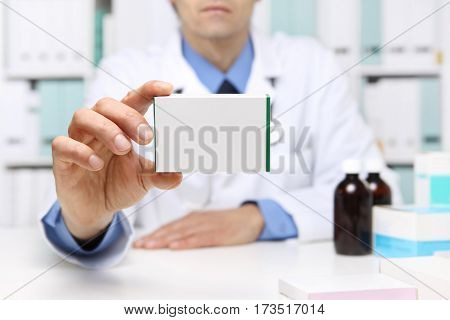 Doctor hand showing drug boxes at Office Desktop. Health care Medical and Pharmacy Concept.