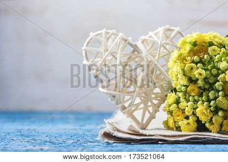 Kalanchoe Flowering Yellow Bouquet And White Heart On A Wooden B