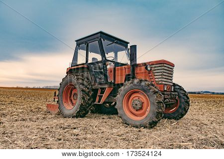Tractor working on the farm, agricultural transport, a farmer working in the field, tractor at sunset, old tractor closeup