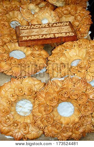 Freshly baked marriage bread for sale in a city centre shop Heraklion Crete Greece Europe.
