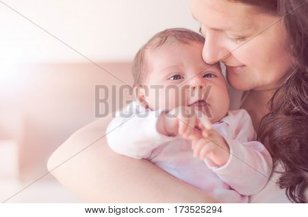 Mother With Her Newborn Baby. Mother Is Holding Her Little Baby Girl.  Photo With The Effect Of Sunl