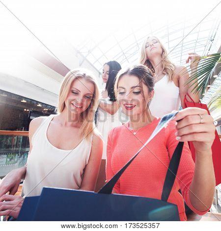 beautiful smiling young women shopping at mall