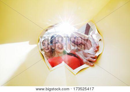 beautiful smiling young women looking inside bag