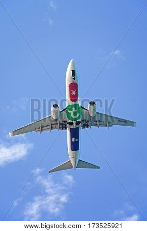 HERAKLION, CRETE - SEPTEMBER 19, 2016 - View of the underside of the Transavia Boeing 737 registration number PH-HZI retracting its wheels Heraklion Crete Greece Europe, September 19, 2016.