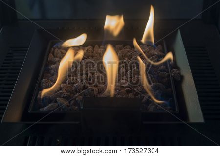 Carbon metal stove with fire heating a room