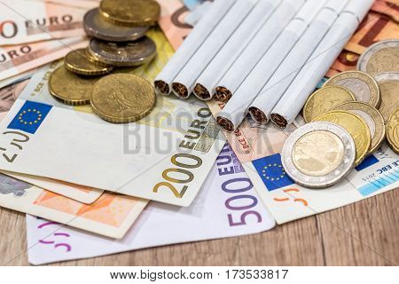 Euro Bills, Euro Coin With Cigarette. Close Up.