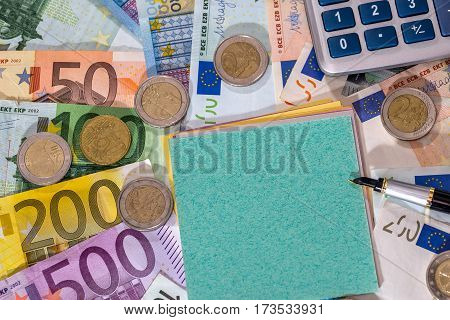 Empty Blank With Euro Bills, Coin And Calculator On Desk.