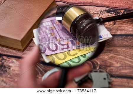 Magnifying Glass With Euros, Hammer, Handcuff And Book.