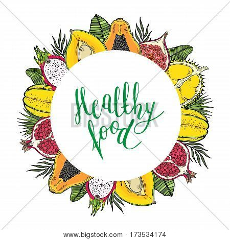 Round frame of fruits and tropical leaves. With the words Healthy food. White background. Lettering.