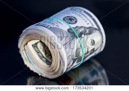 Close Up Of Dollar Roll With Band Isolated On Black Background.