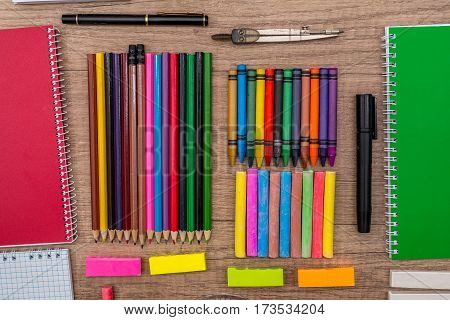 School Supplies - Colored Chalks And  Pencils On A Wooden Background.