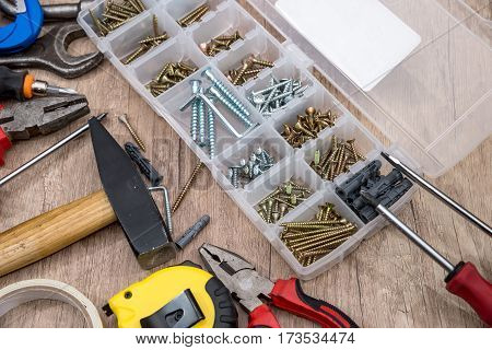 set of tools and instruments screw on wooden background.