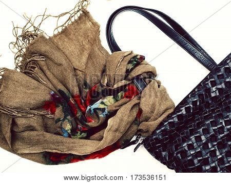 female bag with scarf over white background