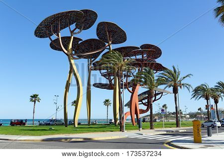 LA PINEDA/ SPAIN - MAY 15. The pine tree sculpture on the seafront promenade on May 15, 2015 in town La Pineda, Spain.
