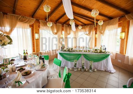 Dining Hall Arranged For A Wedding In White And Green Colors
