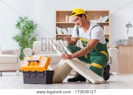 Worker repairing furniture at home