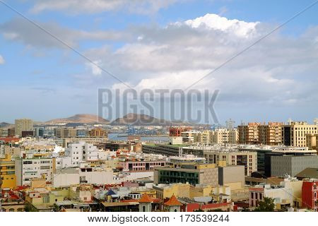 Aerial view on Las Palmas de Gran Canaria. Gran Canaria Spain - 13.02.2017. City landscape with colorful houses the port Puerto de Las Palmas and the ocean in a beautiful sunny day.