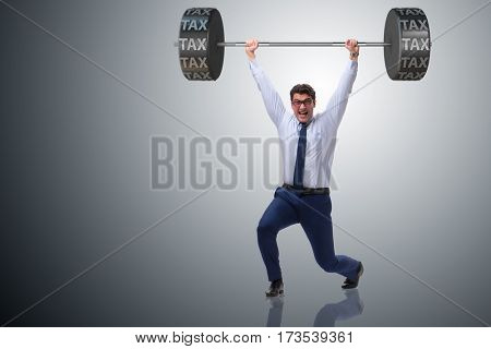 Businessman under  heavy burden of taxes