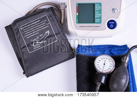The medical equipment - manual and electronic blood pressure monitor. Not in isolation