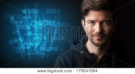 Portrait of a young businessman with blue numbers next to him on a dark background