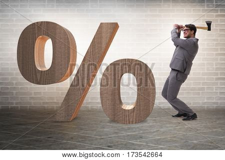 Angry man with axe axing the percentage sign
