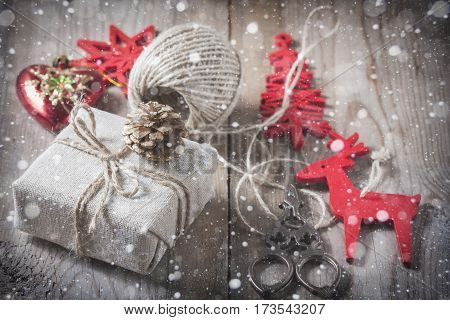 Gift Box Wrapped Linen Cloth And Decorated With  Cord, Jute, Christmas Decoration On Brown Vintage W