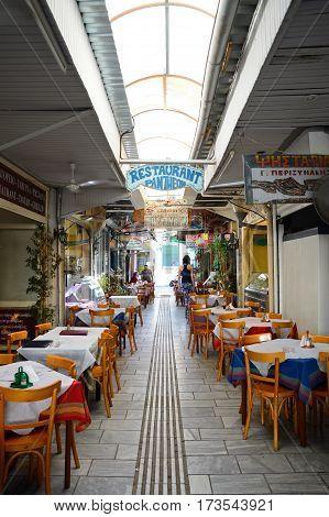 HERAKLION, CRETE - SEPTEMBER 19, 2016 - Alleyway lined with restaurants along Odos 1821 Heraklion Crete Greece Europe, September 16, 2016.