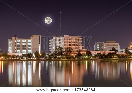 Building a city on the moon reflecting pool at night.