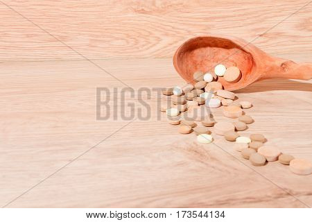 Close-up Of Pills And Spoon
