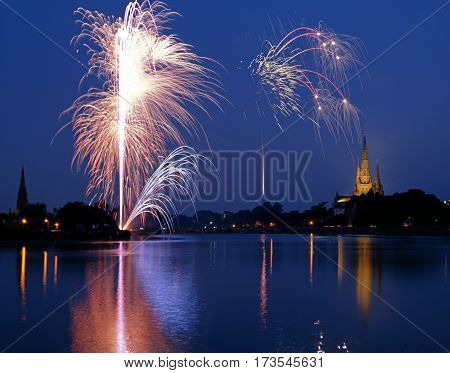 Firework Festival display over Stowe Pool with the Cathedral to the rear Lichfield Staffordshire England UK Western Europe.