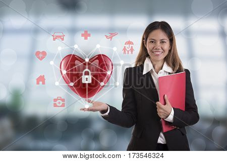 business salesman agent hand holding red heart. concept accident prevention healthcare insurance.