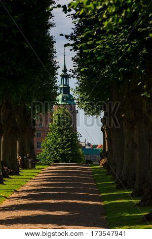 A Beautiful Summer Green Ale Leading To Frederiksborg Palace In Denmark