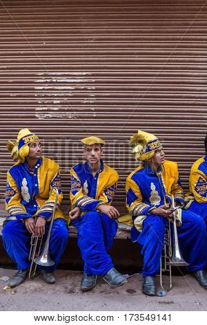 Vrindavan, India - March 20, 2016: Portrati of unidentified indian musicians from traditional wedding band on the street of Vrindavan, India