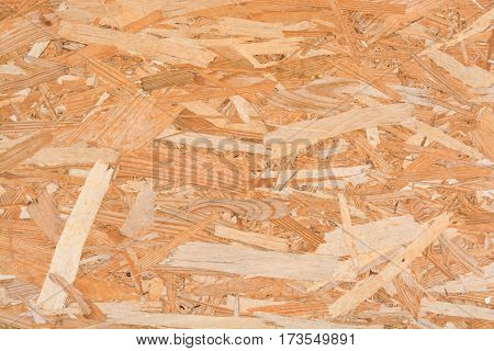 Seamless pressed wooden panel or strand board OSB background