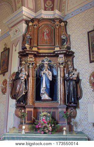 MARTINSKA VES, CROATIA - JUNE 03: Immaculate heart of Mary altar in Parish Church of Saint Martin in Martinska Ves, Croatia on June 03, 2011.