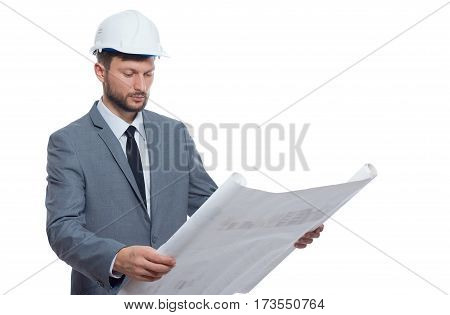 Diligent professional. Handsome mature bearded male architect wearing hardhat looking serious while examining blueprints isolated on white professionalism experience confidence project urban concept