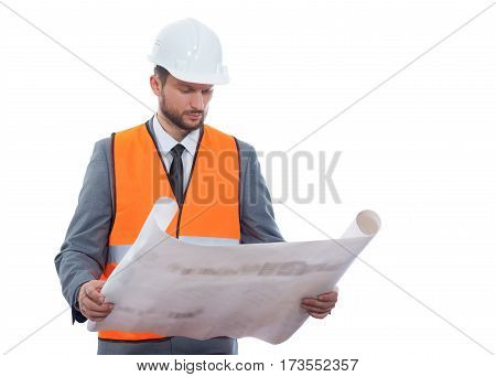 Plans improvement. Handsome mature bearded foreman in a formal suit and safety vest going through building project blueprints isolated on white copyspace professionalism confidence building industry