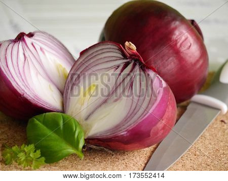 red onion whole and the cut, leaf of basil and parsley