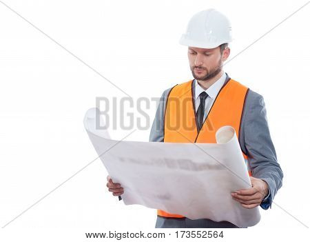 Construction creativity. Confident businessman engineer holding blueprints posing confidently on white background wearing protective helmet and safety vest copyspace profession businesspeople concept