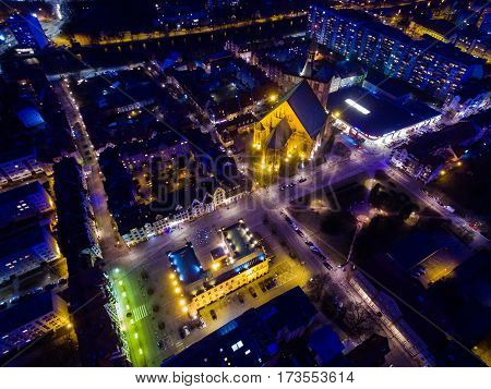 Aerial night view of the old town of Kolobrzeg in Poland winter time